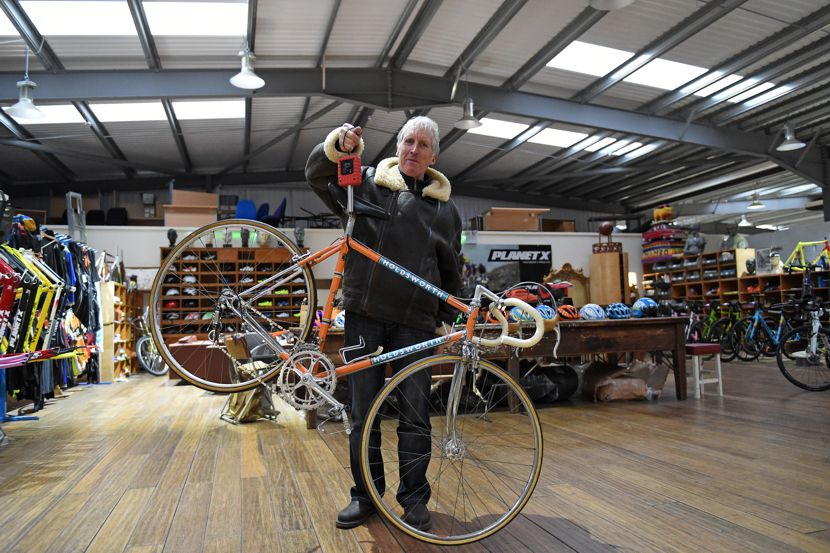 Image of Keith Lambert weighing a Holdsworth bike