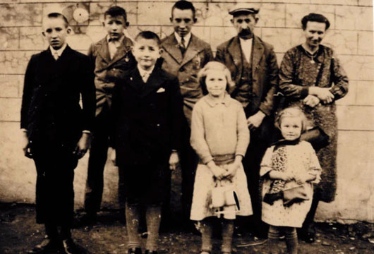 The Schotte family, Briek back row left and mum and dad back row right.