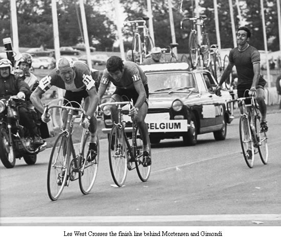 Image of Les West crossing the finish line behind Mortensen and Gimondi